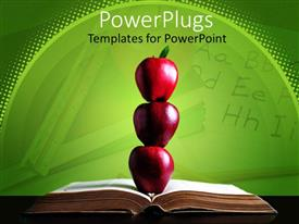 PowerPoint template displaying stack of three red apples on the middle of opened book and letters in the green background