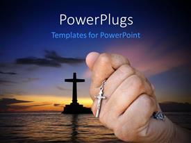 PowerPoint template displaying sun set view of a closed hand holding a rosary