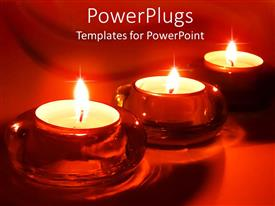 PowerPlugs: PowerPoint template with three burning tea light candles in red glass candle holders