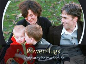 PowerPlugs: PowerPoint template with two adults with two kids smiling and kneeling on grass