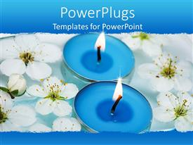 PowerPlugs: PowerPoint template with two blue scented spa candles lit on water with white flowers
