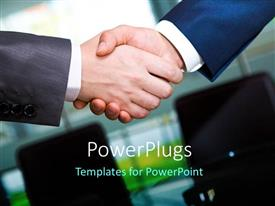 PowerPlugs: PowerPoint template with two business men shaking hands on a blurry background