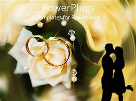 PowerPlugs: PowerPoint template with two golden wedding rings on a white rose and the shade of a kissing couple on an abstract background
