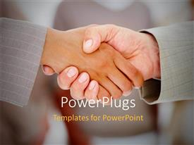 PowerPoint template displaying two people having a handshake over a blurry background