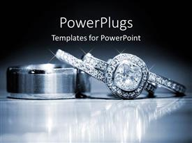 PowerPlugs: PowerPoint template with two shinning diamond studded rings on a reflective surface