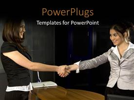 PowerPoint template displaying two smiling young women shaking hands over document on desk