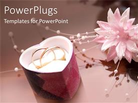 PowerPlugs: PowerPoint template with two wedding rings in a heart shaped jewelry gift box with wedding flower