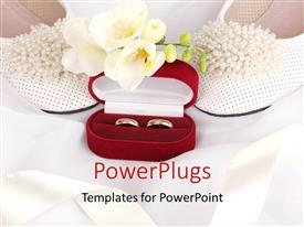 PowerPoint template displaying two wedding rings in a red casing and white flowers