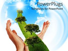 PowerPoint template displaying two woman hands holding a line of green grass with trees going to sun through white clouds on bright blue sky