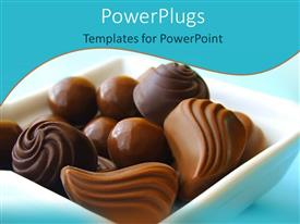 PowerPoint template displaying various chocolate balls and chocolate candies in a bowl on light blue background