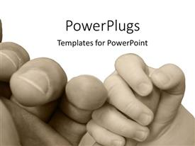 PowerPlugs: PowerPoint template with vintage black and white depiction of baby hand holding parent hand, parenting, child holding finger of adult