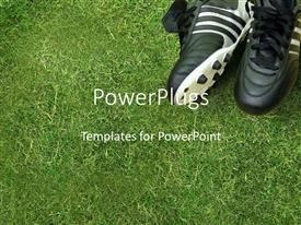 PowerPoint template displaying white and black colored sport boots with spikes on grass