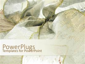 PowerPoint template displaying white and gold colored festival ribbon meshed up together