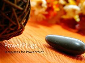 PowerPoint template displaying willow ball and spa stone sitting on bamboo mat