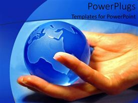 PowerPlugs: PowerPoint template with woman hand holding glossy blue globe on blue background