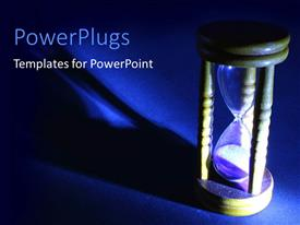 PowerPlugs: PowerPoint template with wooden hour glass with a bright light and blue background