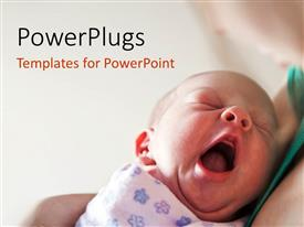 PowerPoint having yawning newborn baby held in mother's arms on light background
