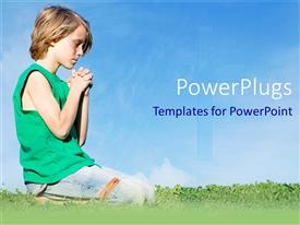 PowerPlugs: PowerPoint template with young boy on praying on knees in grass