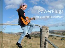 PowerPlugs: PowerPoint template with young girl playing guitar sitting on top of fence in countryside scenery